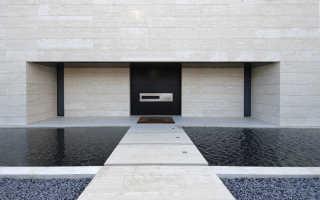 Облицовочные панели для фасада дома под камень
